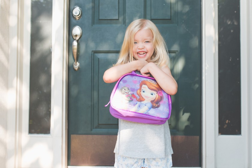 girl holding her new school lunchbox by Tiffany Kelly