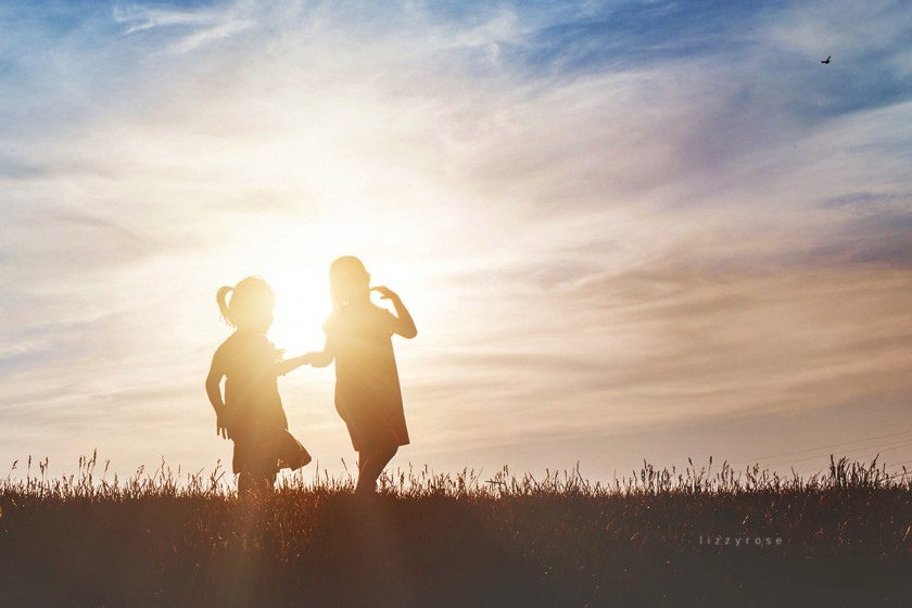 silhouette photo of two girls by Lisa Furey