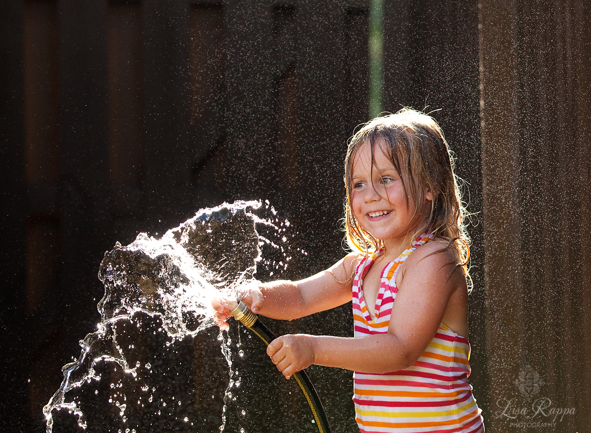 water hose fun by Lisa Rappa