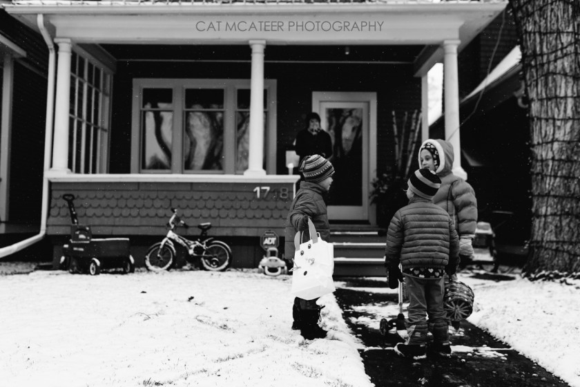 black and white picture of kids playing in the snow by Cat McAteer
