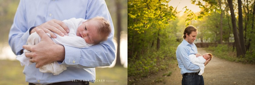 dad holding new baby outside by Beth Ann Fricker