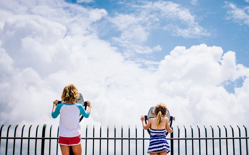 girls looking into the sky by Kate T Parker