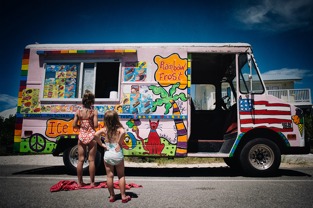 girls standing at an ice cream truck by Kate T Parker