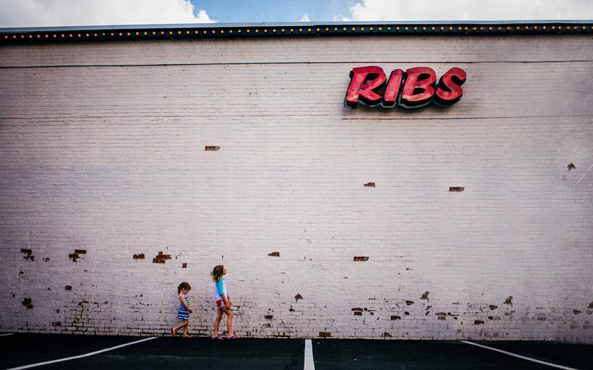 kids by a ribs sign by Kate T Parker