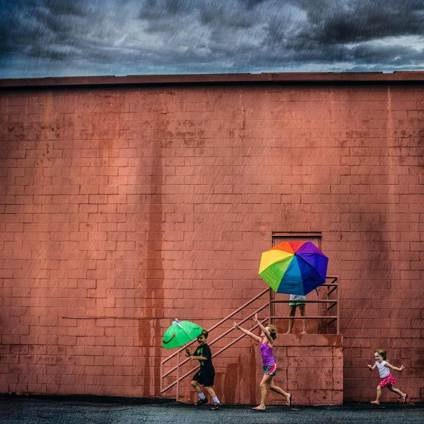 kids playing in the rain photo by Kate T Parker