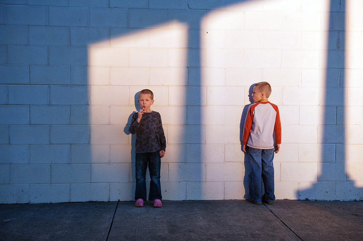 two brothers standing in the light by Meredith Novario