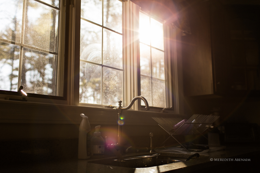 Gorgeous Light Shining Through Kitchen Window And Reflecting Off