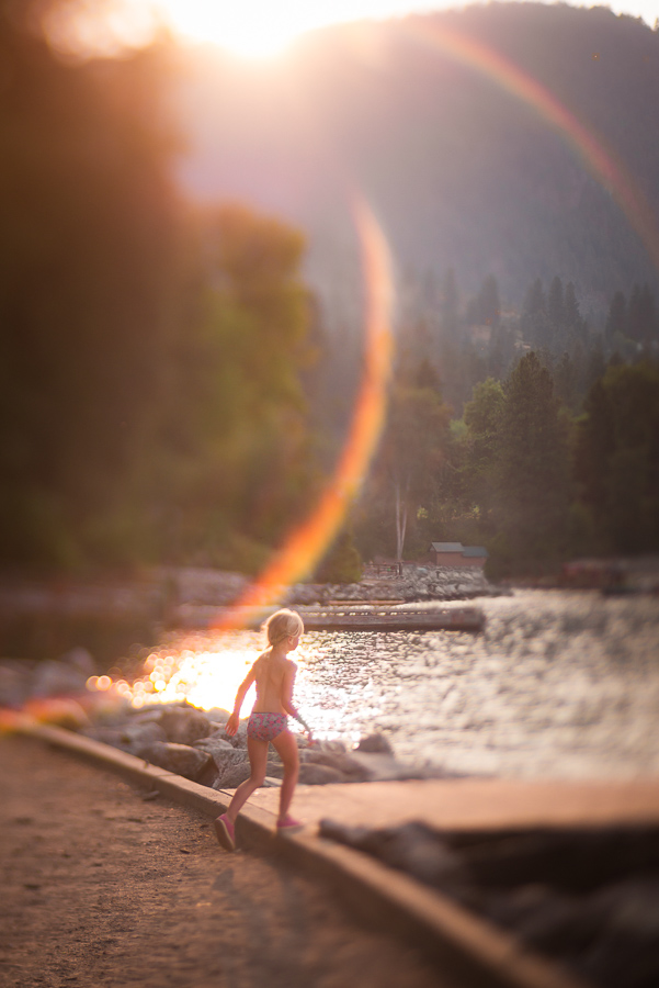 Lensbaby-Photo-of-Child-on-Beach-and-Creative-Rainbow-Flare-by-Erin-Wagnild