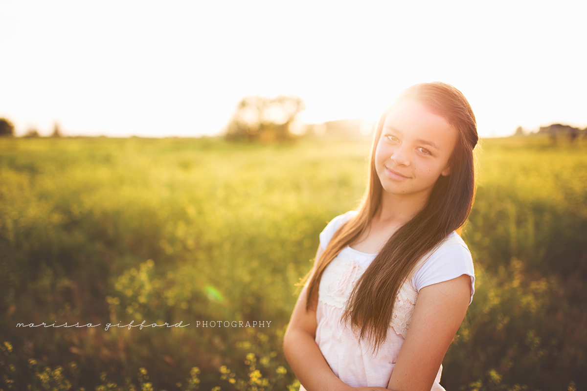 backlit photo of girl in a field by Marissa Gifford