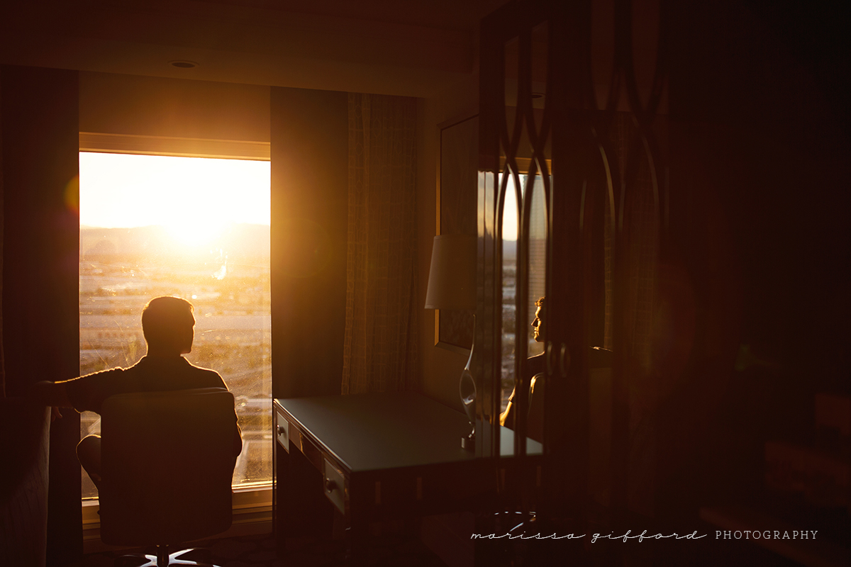 backlit portrait of man in a hotel by Marissa Gifford
