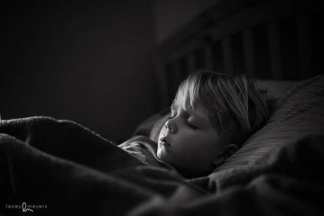 black and white picture of boy sleeping by Lacey Meyers