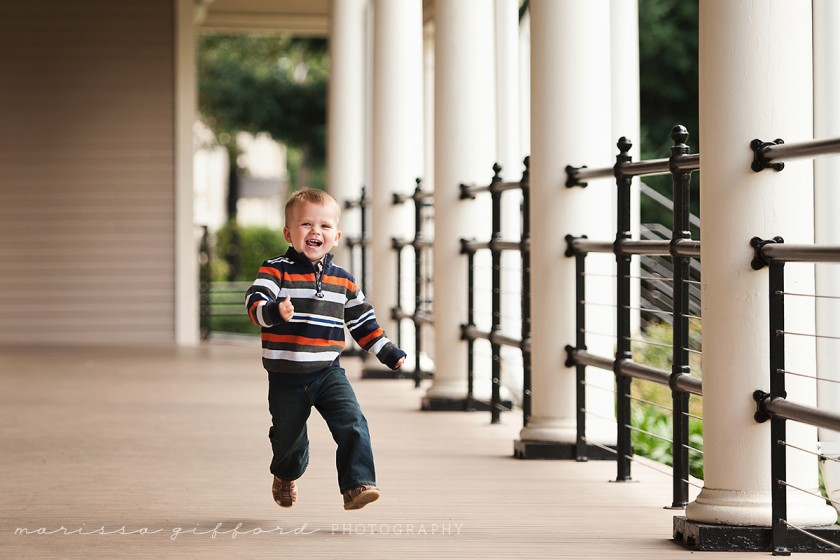 boy running happily by Marissa Gifford