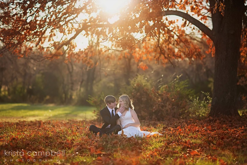bride and groom under a fall tree by Krista Campbell