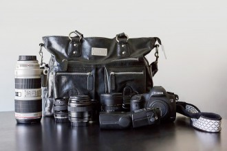 camera bag and Canon camera and lenses of photographer Rachel Nielsen