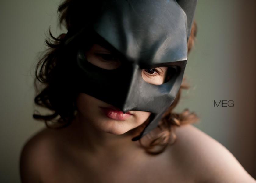 child wearing Batman mask by Meg Bitton