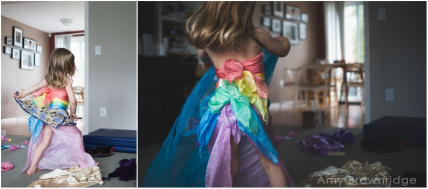 girl playing dress up by Amy Brownridge