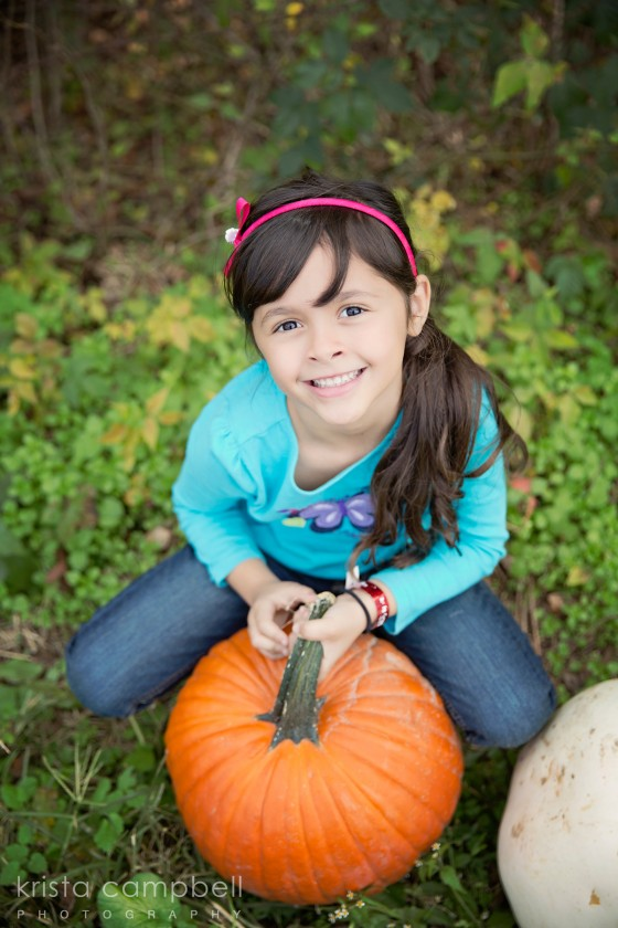 girl sitting with a pumpkin picture by Krista Campbell