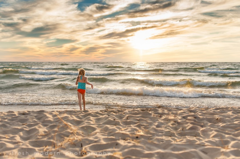 girl standing on the beach by Mickie DeVries of Fresh Modern Photography