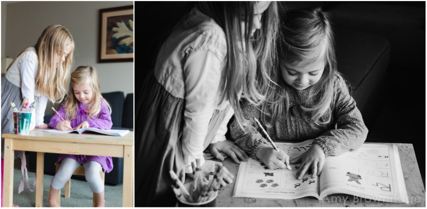 girls writing in an activity book by Amy Brownridge