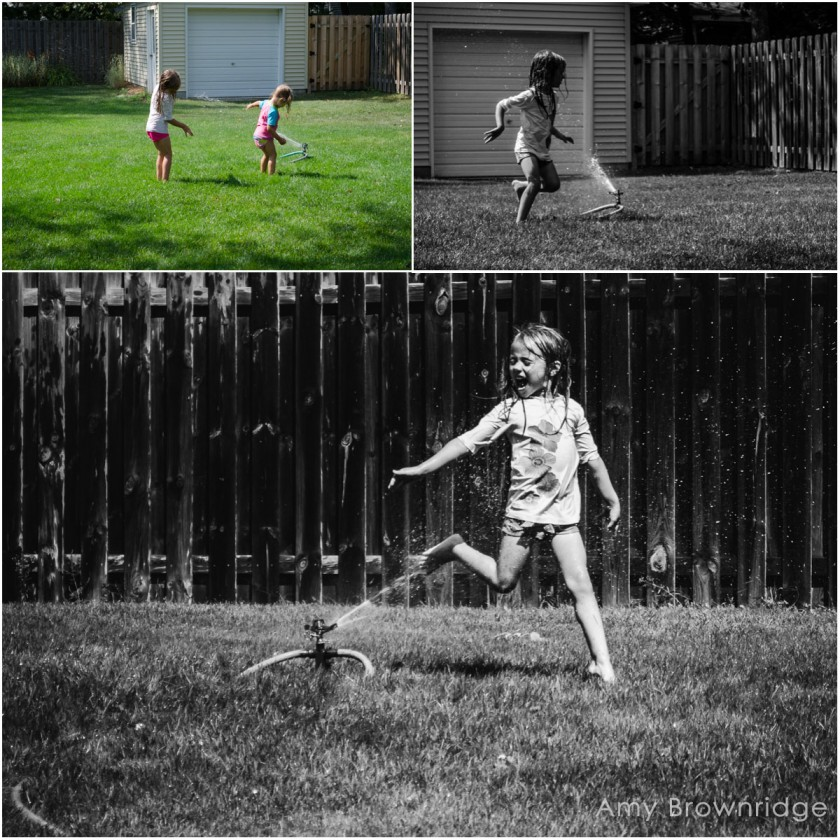 kids playing in the sprinkler by Amy Brownridge