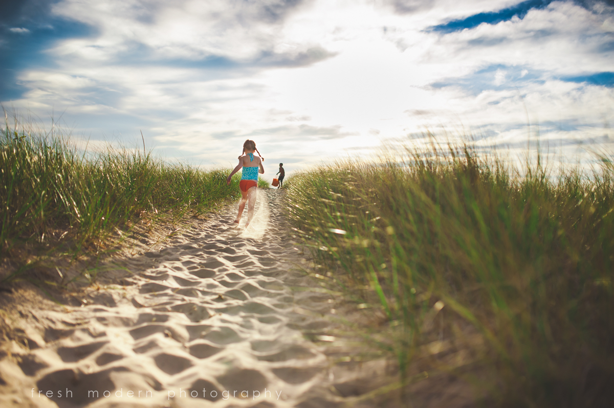 kids playing on the beach by Mickie DeVries of Fresh Modern Photography