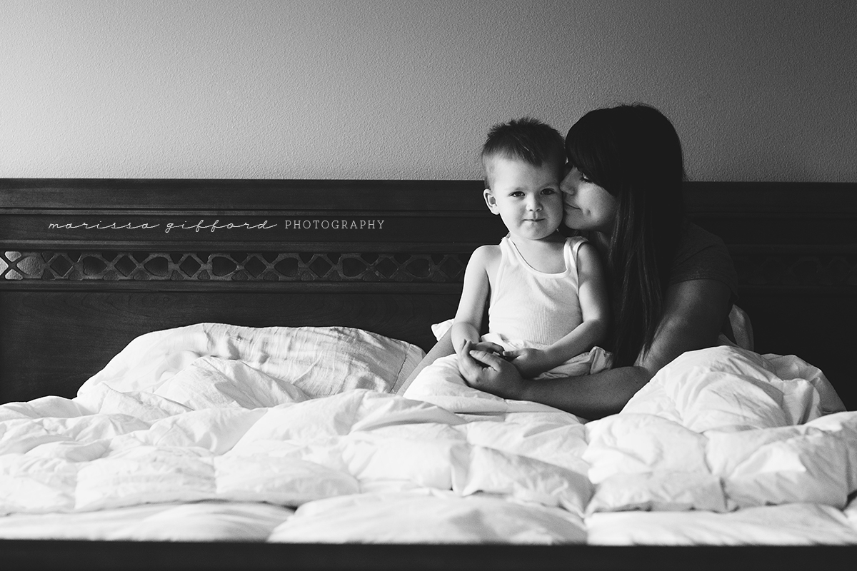 mom and son snuggling in bed by Marissa Gifford