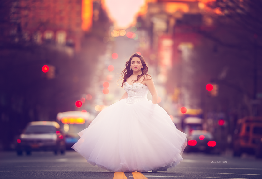 teen girl wearing white dress in the middle of a street by Meg Bitton