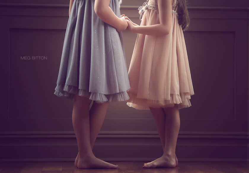 two girls holding hands by Meg Bitton