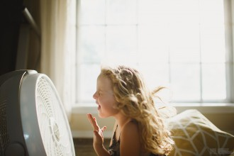 child singing into a fan by April Nienhuis