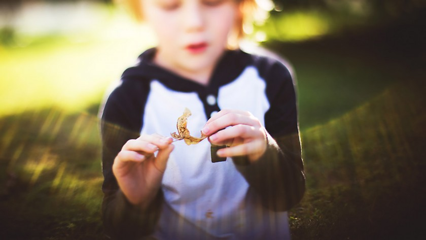kid holding a leaf by Erin Hensley