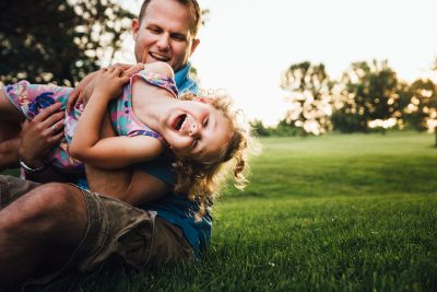photo of dad making daughter laugh by Virginia Greuloch