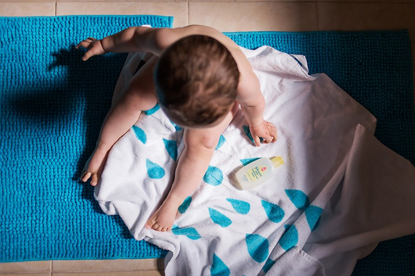 toddler sitting on a towel by Erin Hensley