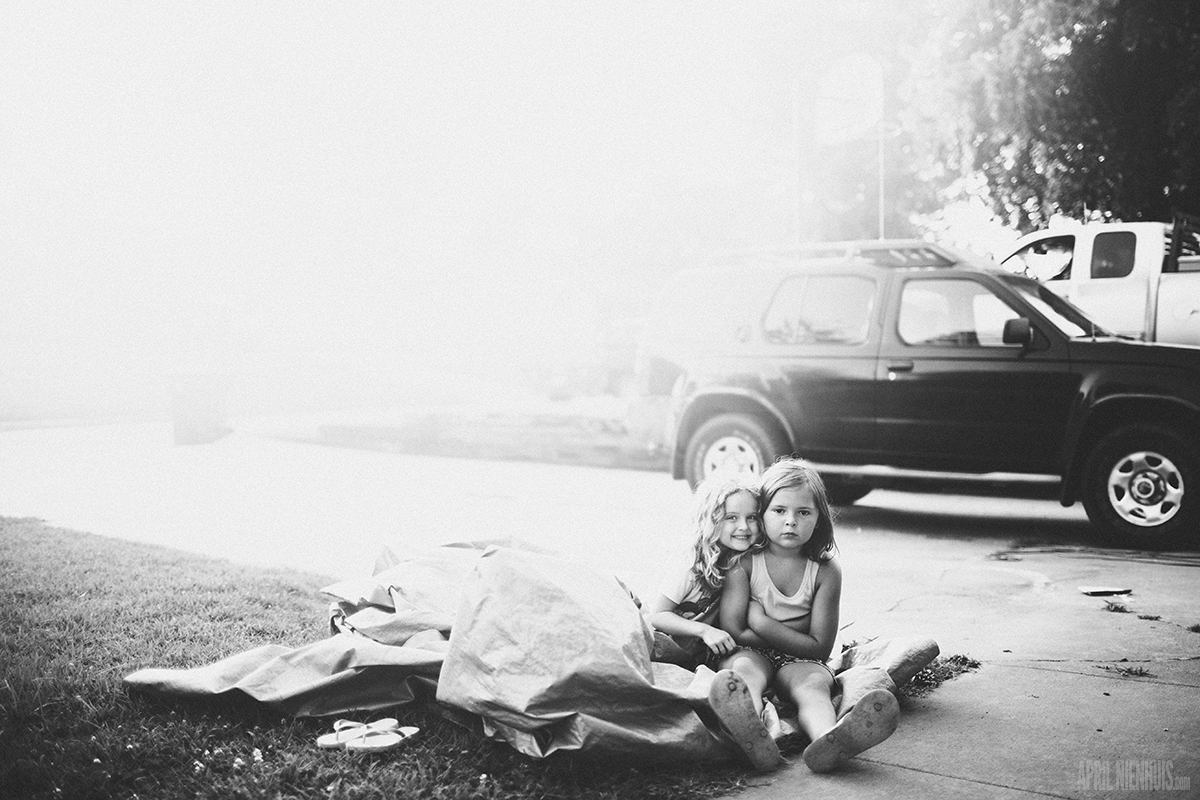 two girls sitting in the driveway photo by April Nienhuis