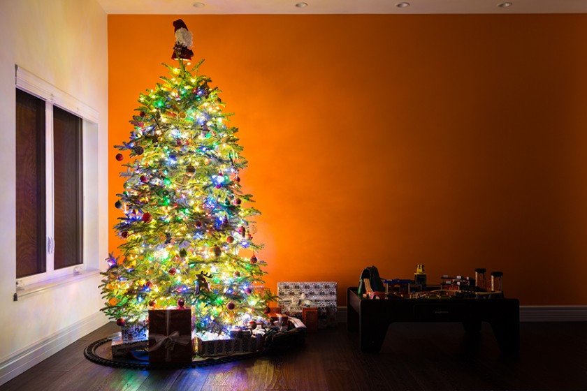 Christmas tree and wrapped presents photo by Vironica Golden