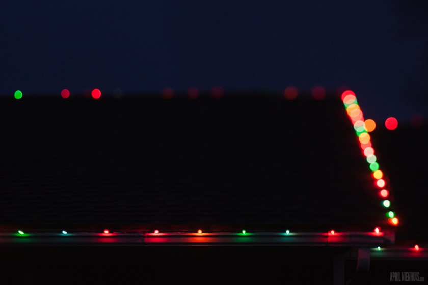 Lensbaby photo of Christmas lights on the house at night by April Nienhuis