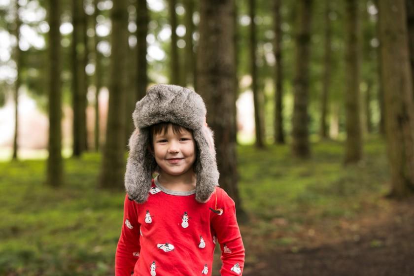 boy in his Christmas pajamas by Kristin Dokoza