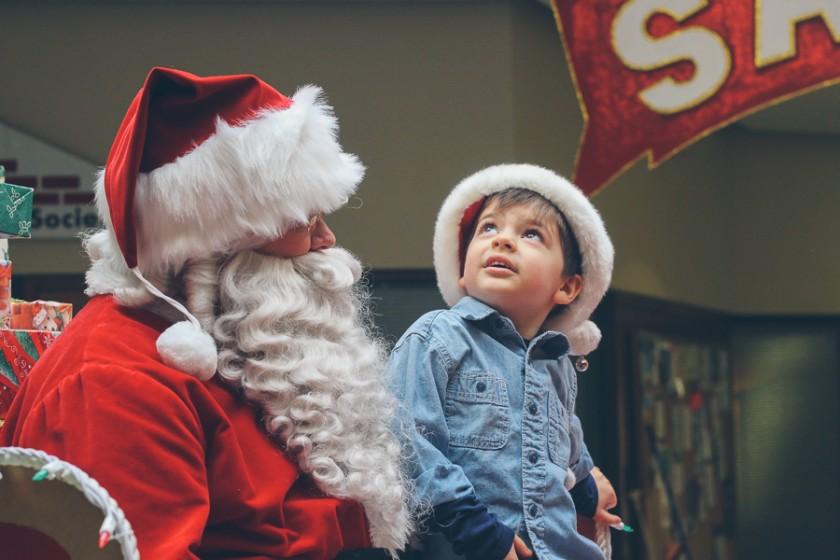 boy sitting on Santas lap by Cassandra Casley