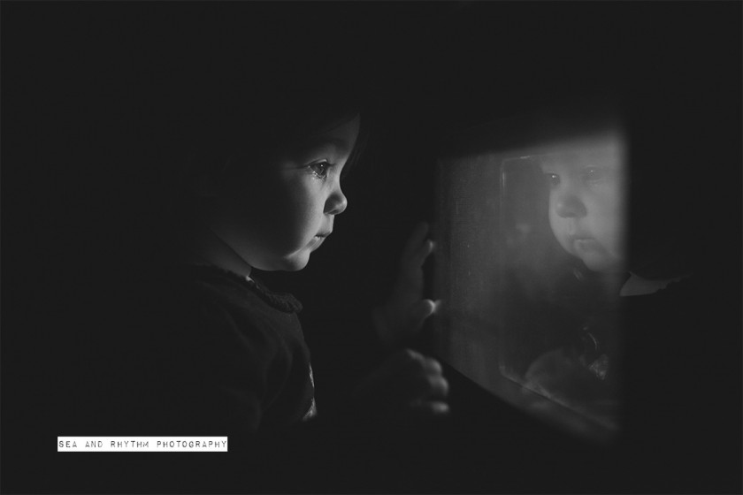 child watching food cook in the oven by Kris and Lauren Penland
