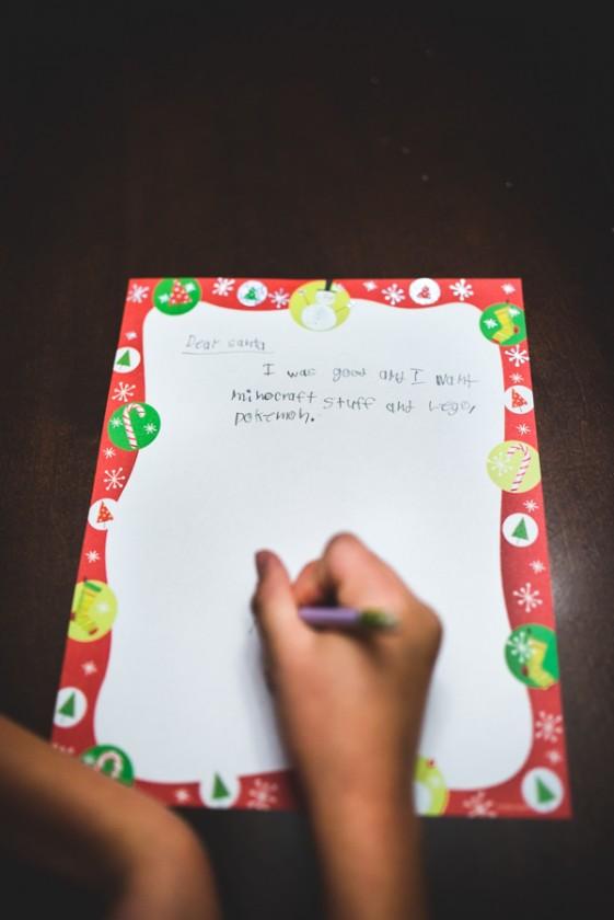 kid writing Santa wish list picture by Mickie DeVries