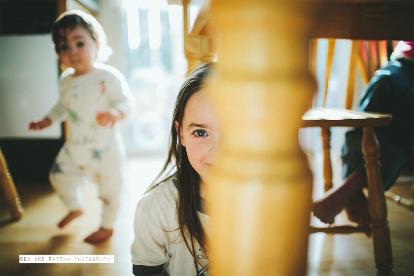 kids playing under the kitchen table by Kris and Lauren Penland