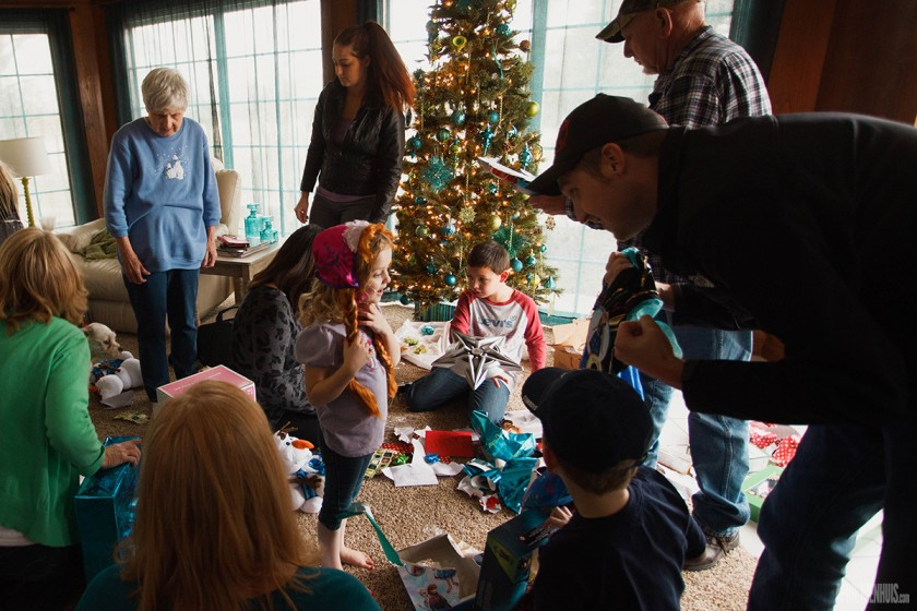 kids unwrapping Christmas presents by April Nienhuis