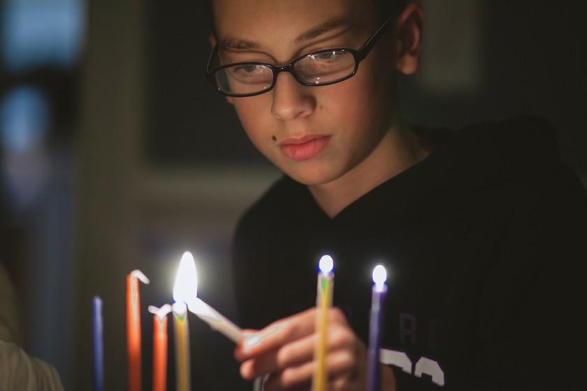 lighting the menorah by Jessica Nelson