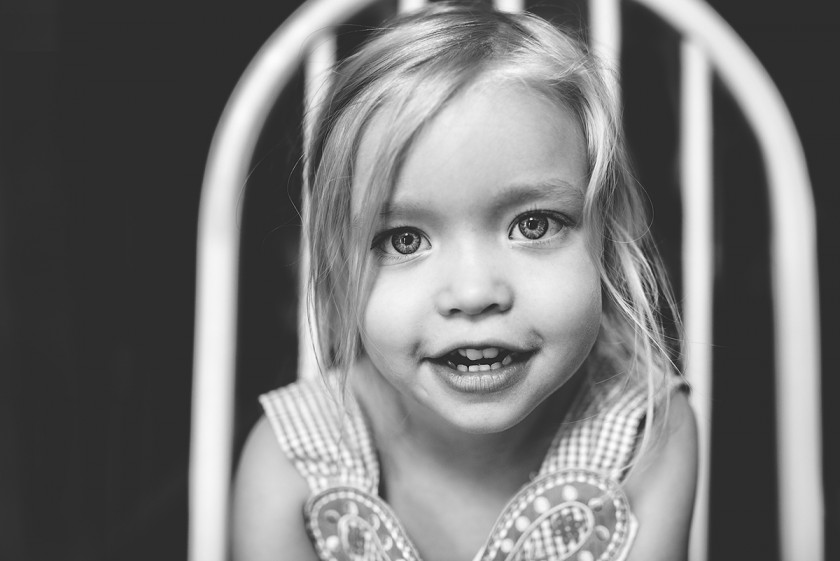 natural light black and white portrait of girl sitting in a chair by Tiffany Kelly