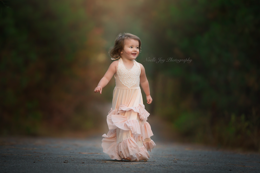 Beautiful-Portrait-of-Little-Girl-Running-in-Fancy-Gown-by-Noelle-Joy