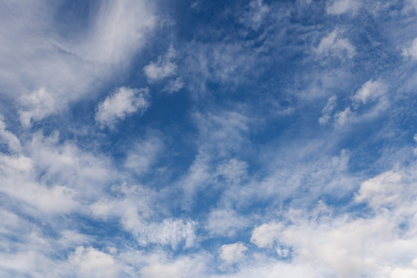 Blue-Sky-and-Clouds-Showcasing-Visual-Flow-by-Dakota-Kerr