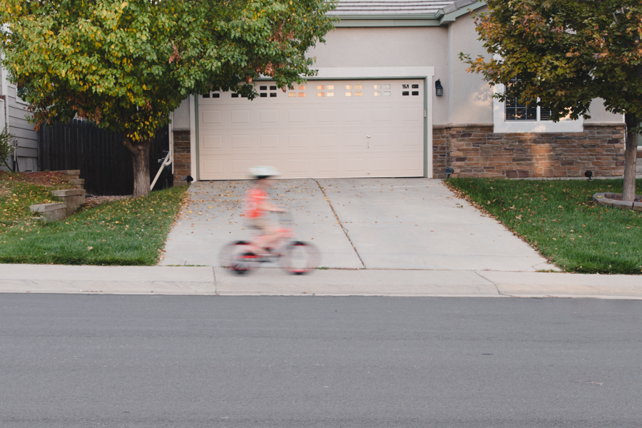 Creative-Motion-Blur-of-Child-Riding-Bike-through-Neighborhood-by-Clickin-Moms-Member-enjoyingnow