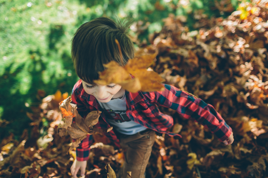 Creative-Overhead-Pic-of-Child-Throwing-Leaves-Up-in-the-Air-by-Cassandra-Casley