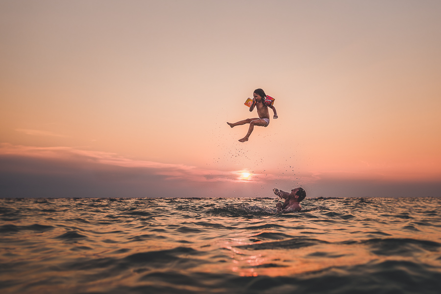 Suspended-Movement-of-Child-being-Thrown-Up-in-Air-in-the-Ocean-by-Playful-Father-by-Anita-Perminova