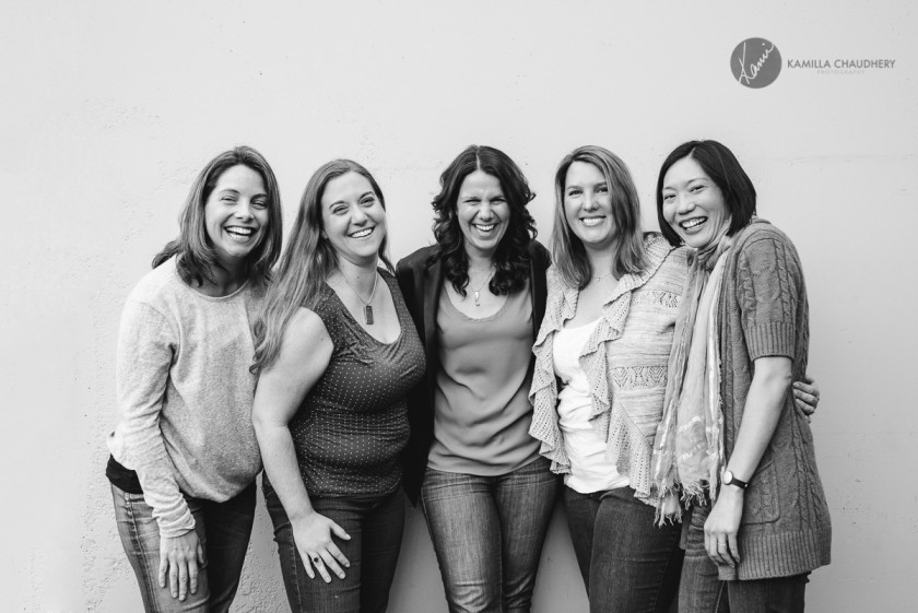 black and white photo of 5 women laughing by Carrie Yuan