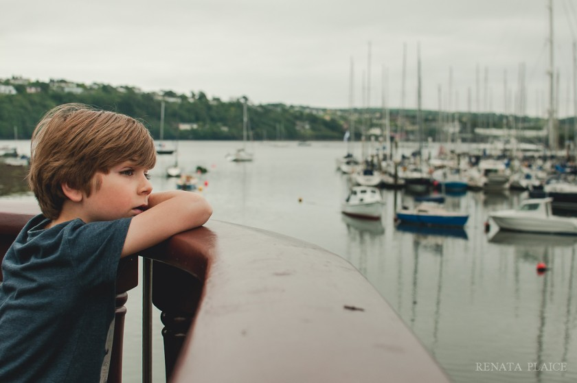 boy looking at a harbor by Renata Plaice